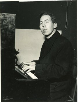Photograph of Rev Desmond Forristal playing the piano